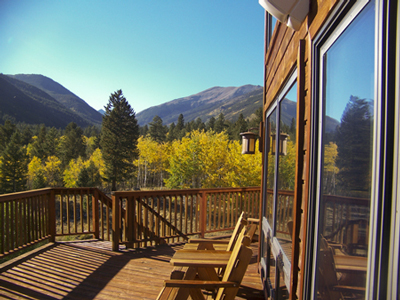 sunny deck with fall aspen and mountains beyond